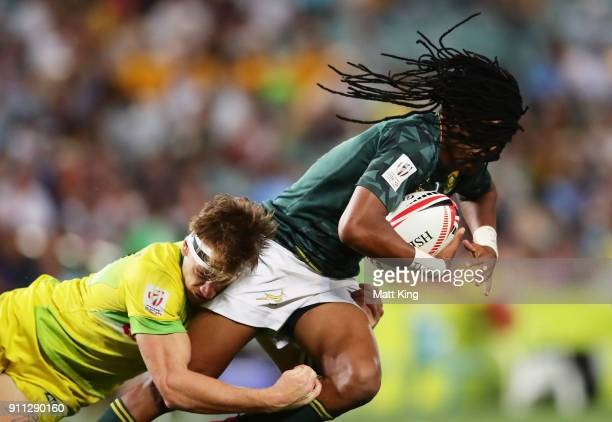 Cecil Afrika of South Africa is tackled by Ben O'Donnell of Australia in the Men's final match during day three of the 2018 Sydney Sevens at Allianz...