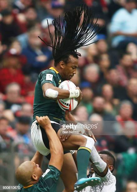 Cecil Afrika of South Africa jumps for the ball against Fiji during the Canada Sevens the Sixth round of the HSBC Sevens World Series at the BC Place...