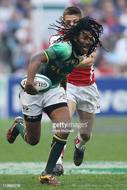 Cecil Afrika of South Africa makes a break against Wales during day two of the IRB Sevens at Hong Kong Stadium on March 26, 2011 in So Kon Po, Hong...
