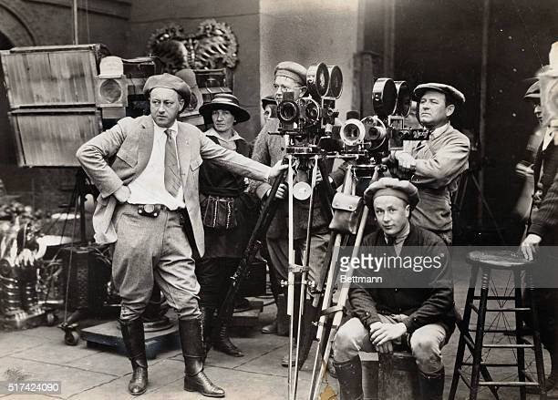 Cecil B DeMille directing one of his early motion pictures ca 1920
