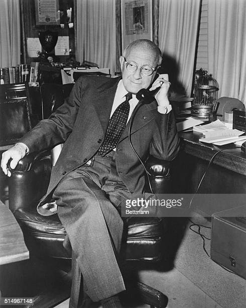 Cecil B. DeMille is shown shortly before his 77th birthday on August 12 where he is seated in his office at Paramount Studios.
