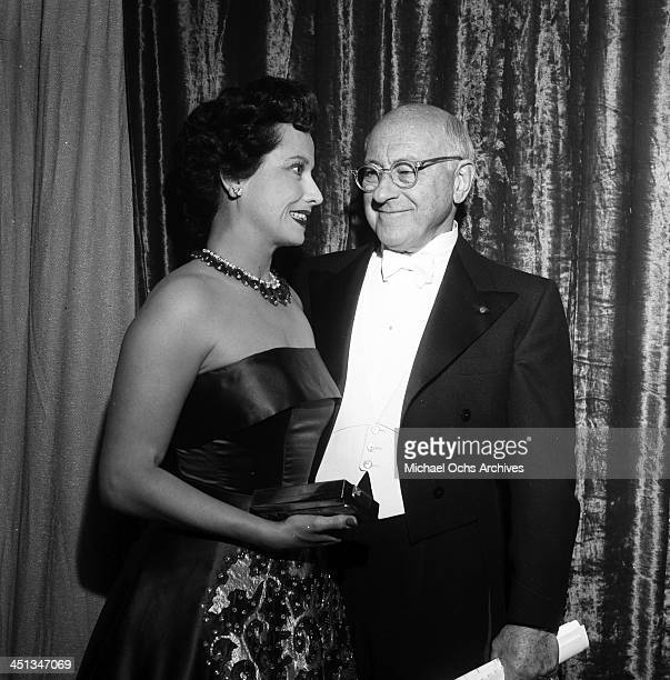 Cecil B DeMille with guest attends the Acadamy Awards in Los Angeles California