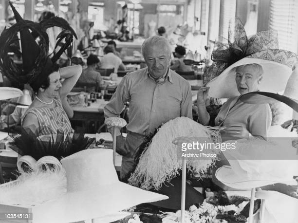 Cecil Beaton fashion and portrait photographer pictured in the costume workshop preparing costumes for the film 'My Fair Lady' Great Britain circa...