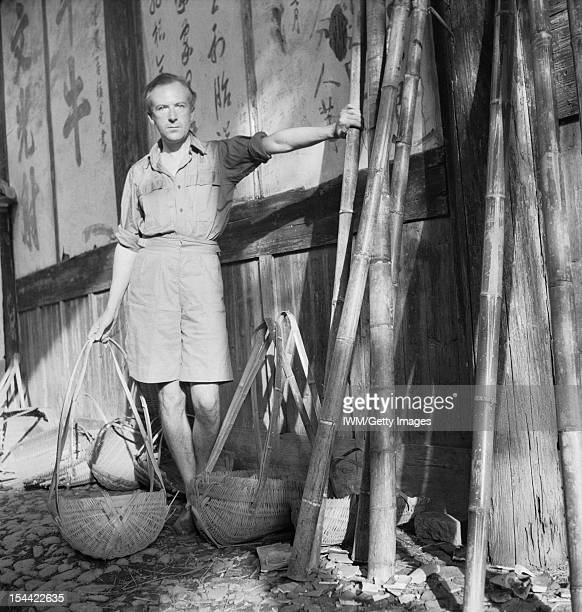 General Cecil Beaton self portraits Cecil Beaton with wicker baskets beside a wall with Chinese characters in Puncheng in south eastern China circa...