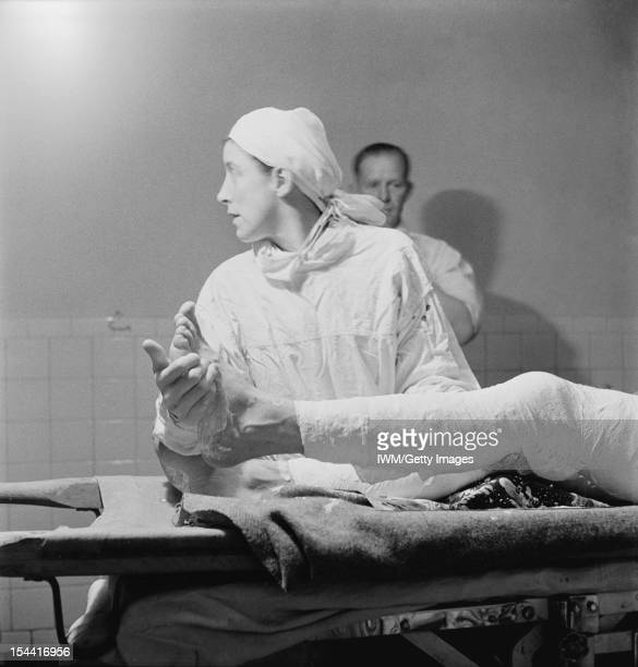 General The Western Desert 1942 An Army nurse caught in profile helping with a leg operation in the operating theatre in the General Hospital in...