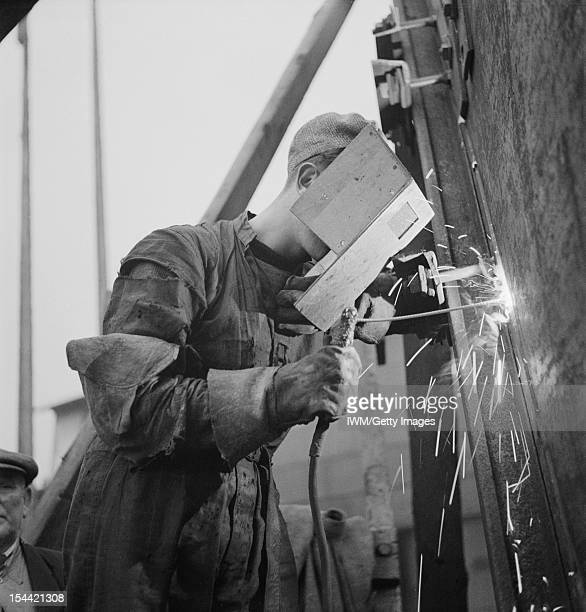 Tyneside Shipyards England Shipbuilding A welder with his protective mask working with a blow torch