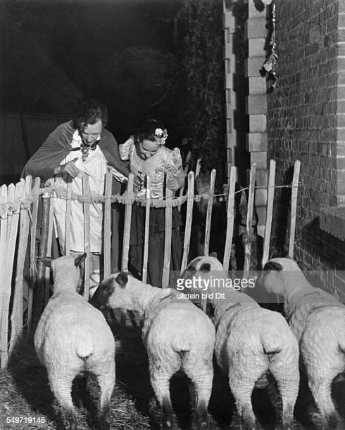 Cecil Beaton, summer party on his country house Ashcombe - couple with sheeps