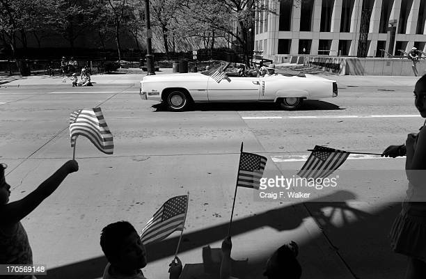 Cecil Bethea rides with his partner Carl Shepherd in a 1972 Cadillac Eldorado on May 25 during the Memorial Day parade in Denver Colo The couple was...