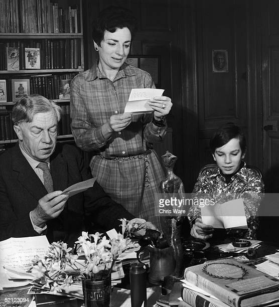 Cecil Day Lewis his son Daniel and wife Jill reading some of the many letters congratulating him on his appointment as Poet Laureate 5th January 1968