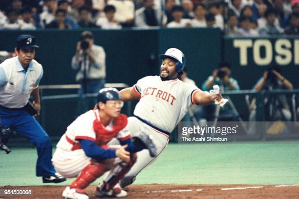 Cecil Fielder of the Detroit Tigers and MLB All Stars slides safely into the home base to score a run during the Game 7 against Japan All Stars at...