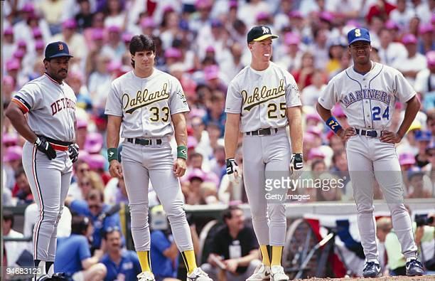 Cecil Fielder of the Detroit Tigers Jose Canseco and Mark McGuire of the Oakland Athletics and Ken Griffey Jr #24 of the Seattle Mariners look on...