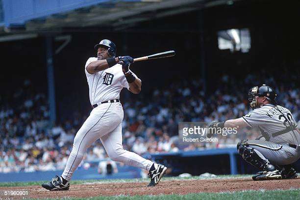 Cecil Fielder of the Detroit Tigers makes a hit during a 1996 season game against the Chicago White Sox. Cecil Fielder played for the Toronto Blue...