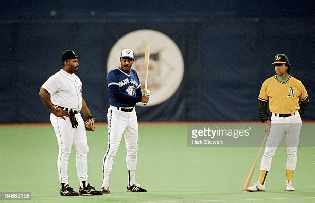 Cecil Fielder of the Detroit Tigers manager Cito Gaston of the Toronto Blue Jays and manager Tony LaRussa of the Oakland Atheltics look on during...