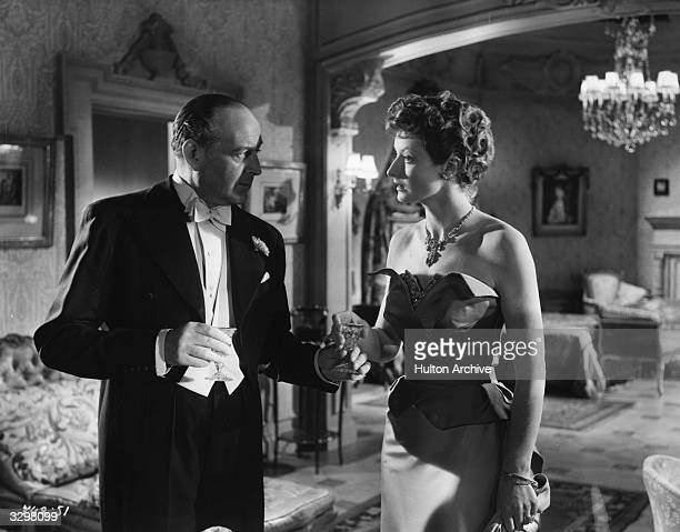Cecil Parker formerly Cecil Schwabe talking with Helen Cherry in a scene from the film 'His Excellency' The film was directed by Robert Hamer for...
