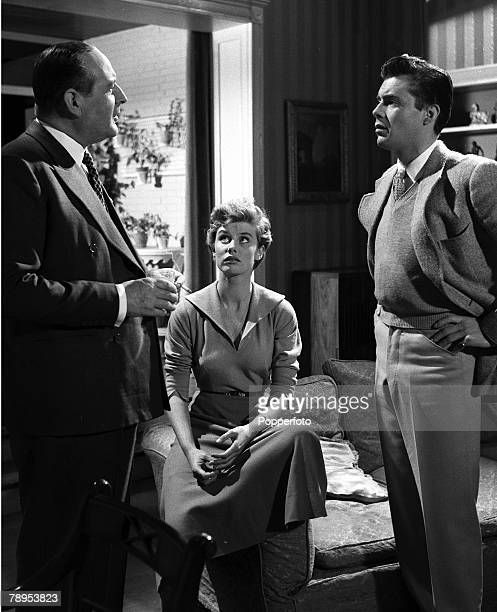Cecil Parker Susan Stephen and Dirk Bogarde during rehearsals for the film 'For Better for Worse' Directed by J Lee Thompson and filmed at Elstree...
