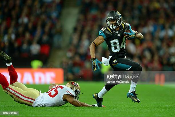 Cecil Shorts III of the Jacksonville Jaguars evades Eric Reid of the San Francisco 49ers during the NFL International Series game between San...
