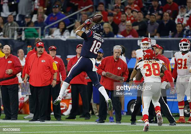 Cecil Shorts of the Houston Texans attempts to catch the ball against the Kansas City Chiefs in the fourth quarter during the AFC Wild Card Playoff...