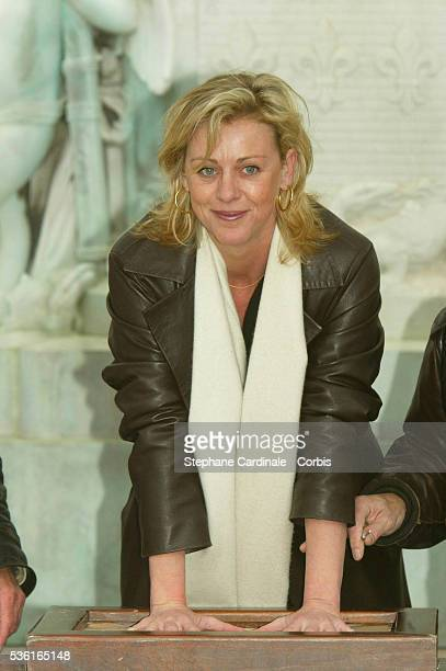 Cecile Auclert moulds her handprint at the 2004 Cognac Film Festival