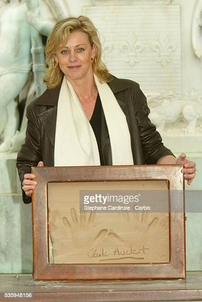 Cecile Auclert shows off her handprint at the 2004 Cognac Film Festival