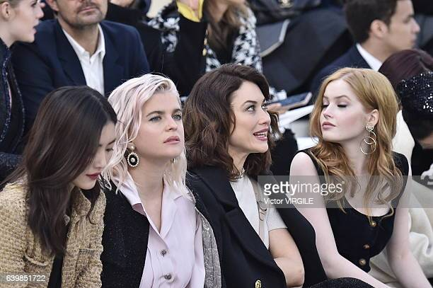Cecile Cassel and Ellie Bamber during the Chanel Spring Summer 2017 show as part of Paris Fashion Week on January 24 2017 in Paris France