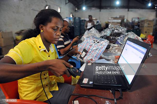 Cecile DE A worker scans a product to ascertain its originality at the Ikeja warehouse of the company in Lagos on June 12 2013 JUMIA is a Nigerian...