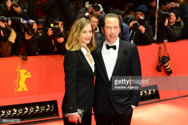Cecile de France and Reda Kateb pose on the red carpet during opening ceremony of the 67th Berlinale International Film Festival at Grand Hyatt Hotel...