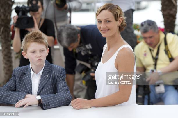 Cecile de France and Thomas Doret pose at the Le Gamin Au Velo Portrait Session during the 64th Annual Cannes Film Festival on May 14 2011 in Cannes...