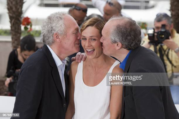 Cecile de France Jean Pierre Luc Dardenne pose at the 'Le Gamin Au Velo' Portrait Session during the 64th Annual Cannes Film Festival on May 14 2011...