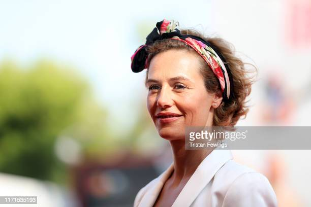 Cecile De France walks the red carpet ahead of The New Pope screening during the 76th Venice Film Festival at Sala Grande on September 01 2019 in...