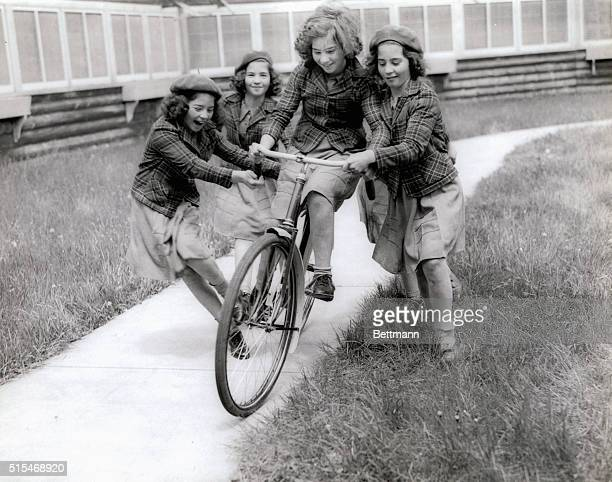 Cecile Emilie Marie Yvonne Annette are learning how to ride a bicycle