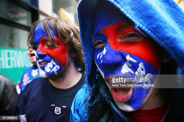 Cecile Monteyne and her brother Jules painted their faces to join other New York Rangers fans in Times Square for a rally in support of their team...
