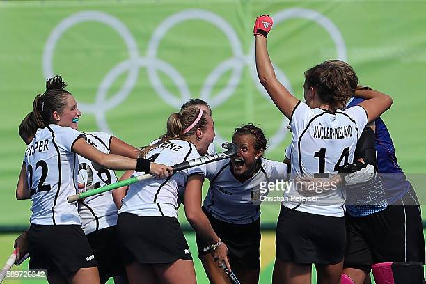 Cecile Pieper Nike Lorenz Selin Oruz and Janne MullerWieland of Germany celebrate after defeating United States 21 in the quarter final hockey game...