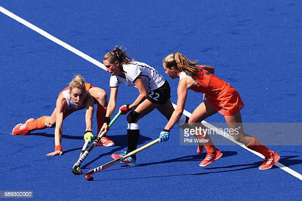 Cecile Pieper of Germany takes the ball forward in the Women's Pool A match between Germany and the Netherlands on Day 8 of the Rio 2016 Olympic...