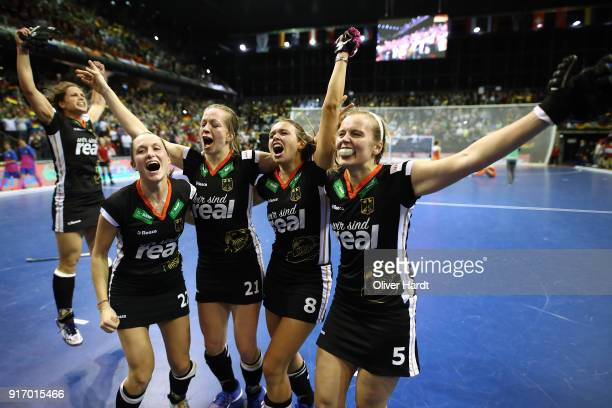 Cecile PieperFranzisca Hauke Anne Schroeder and Viktoria Huse of Germany celebrate after the Women Gold Medal Indoor Hockey World Cup Berlin Final...