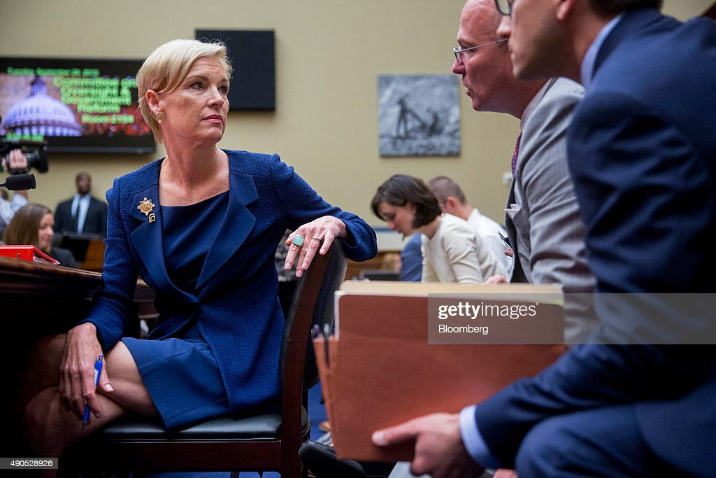 Cecile Richards, president of Planned Parenthood Federation of America Inc., left, talks to assistants before a House Oversight and Government Reform Committee hearing in Washington, D.C., U.S., on Tuesday, Sept. 29, 2015. Conservative House Republicans have demanded a government shutdown if lawmakers don't defund Planned Parenthood, the women's reproductive health-care provider whose services include abortion. Photographer: Andrew Harrer/Bloomberg via Getty Images