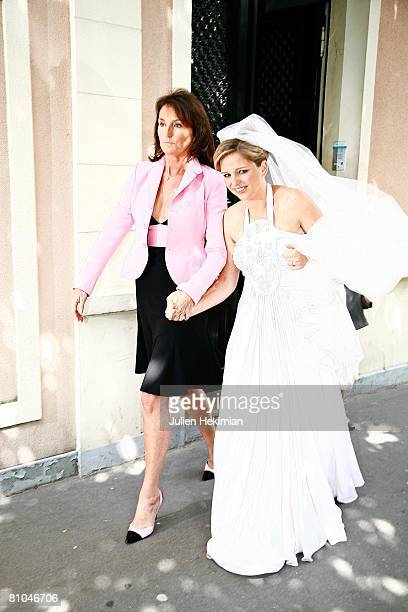 Cecilia Attias and her daughter JeanneMarie Martin leave Richard Attias' house to go to the St Pierre de Neuilly church on May 10 2008 in Paris France