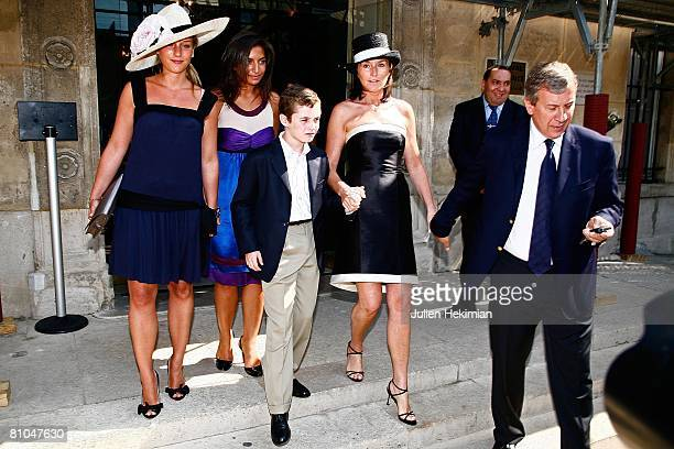Cecilia Attias and her son Louis Sarkozy and Richard Attias leave the town hall of Paris 7th after the civil wedding of JeanneMarie Martin and Gurvan...