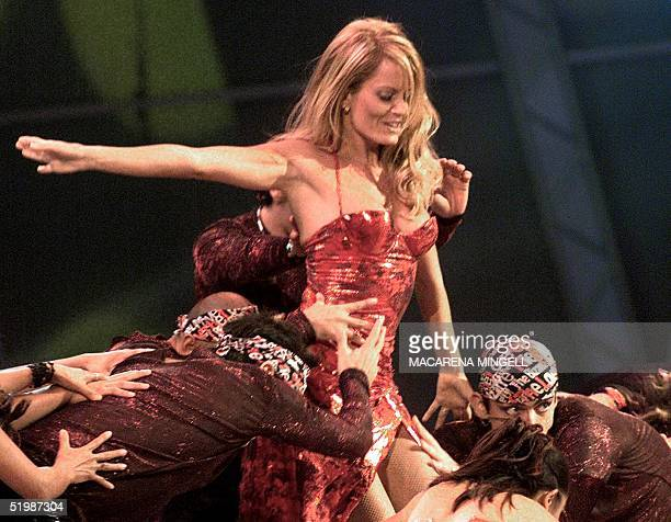 Cecilia Bolocco former Miss Universe and wife of former Argentine president Carlos Menem performs at the Vina del Mar Music Festival Chile late 25...