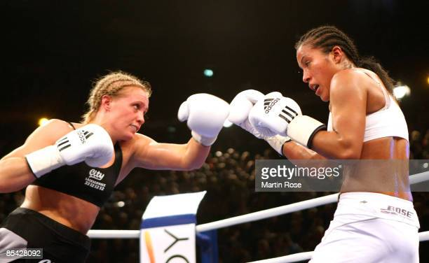 Cecilia Braekhus of Norway and Vinni Skovgaard of Denmark in action during the WBA/WBC World Championship fight between Cecilia Braekhus and Vinni...
