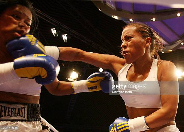 Cecilia Braekhus of Norway and Wanda Pena Ozuna of the Dominican Republic in action during the light welterweight at the Tempodrom on January 26 2008...