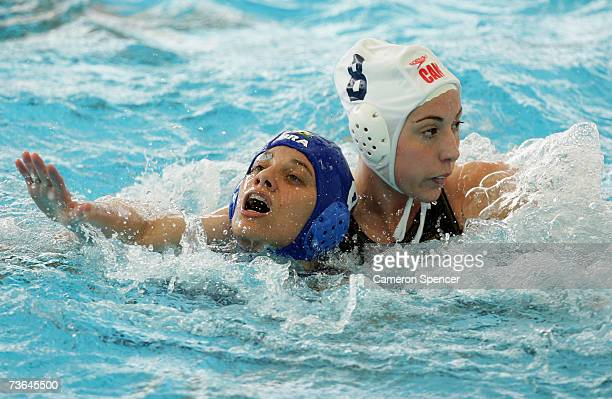 Cecilia Canetti of Brazil and Dominique Prerreault of Canada work for position in the Women's Preliminary Round Group B Water Polo match between...