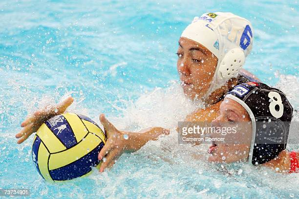 Cecilia Canetti of Brazil battles with Noeki Klein of Netherlands in the Women's Final Round 9th10th place Water Polo match between Brazil and...