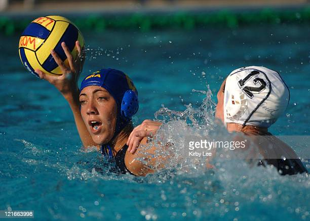 Cecilia Canetti of Brazil is defended by New Zealand's Kimberly Sumich during FINA World League women's semifinal at the USA Water Polo National...
