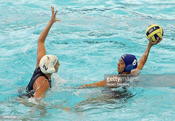 Cecilia Canetti of Brazil looks to pass with Blanca Gil Sorli of Spain in defence during the Women's Final Round Water Polo match between Spain and...