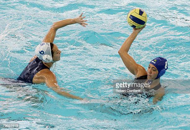 Cecilia Canetti of Brazil looks to pass with Jennifer Pareja Lisalde of Spain in defence during the Women's Final Round Water Polo match between...