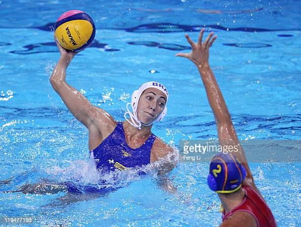 Cecilia Canetti of Brazil shoots past Blanca Gil Sorli of Spain in the Women's Water Polo first preliminary round match between Brazil and Spain...