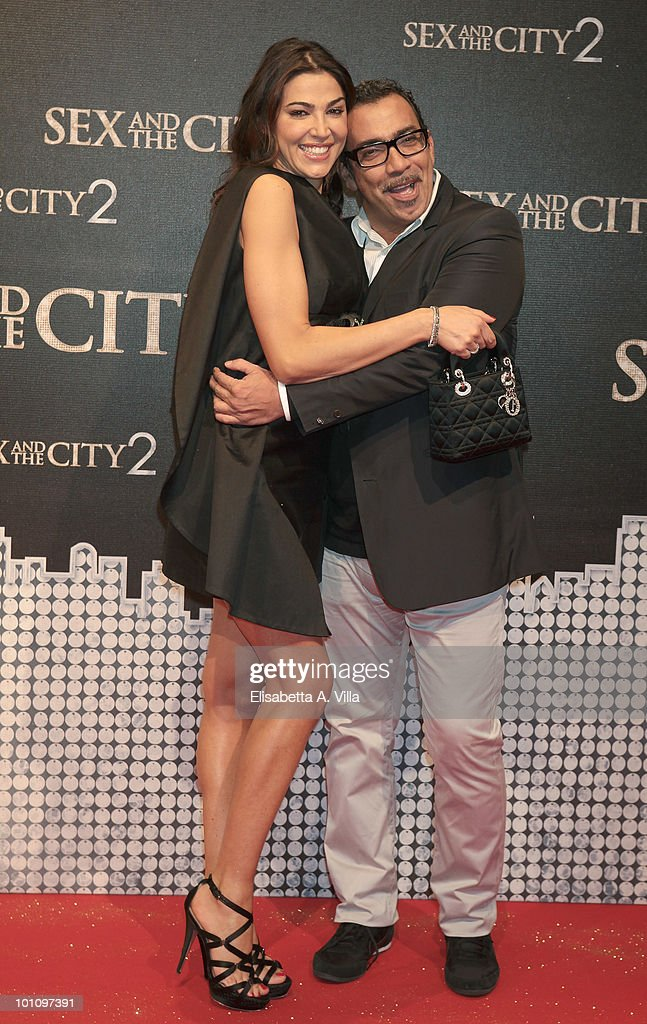 Cecilia Capriotti (L) and designer Guillermo Mariotto attends 'Sex & The City 2' premiere at Warner Moderno Cinema on May 27, 2010 in Rome, Italy.
