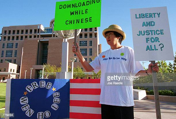 Cecilia Chang holds signs in support of former Los Alamos computer scientist Wen Ho Lee September 13 2000 in front of the federal courthouse in...