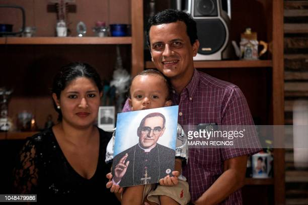 Cecilia Flores his husband Alejandro Rivas and their son Luis Carlos are pictured at their home with the image of blessed Monsignor Oscar Romero...
