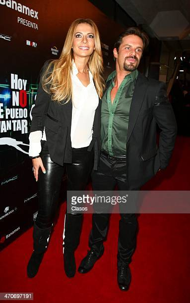 Cecilia Galeano and Mark Tacher attend the red carpet of Hoy no me puedo levantar at Almada Theater on February 18 2014 in Mexico City Mexico